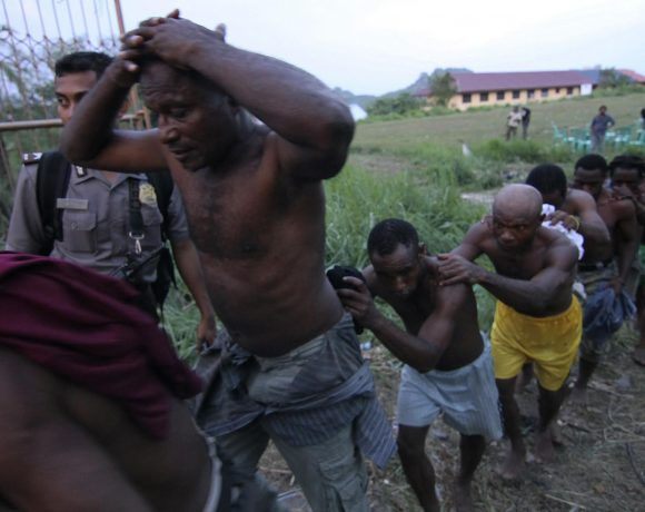 Indonesian police arrest attendees of the Third Papuan People Congress in Abepura. October 2011.